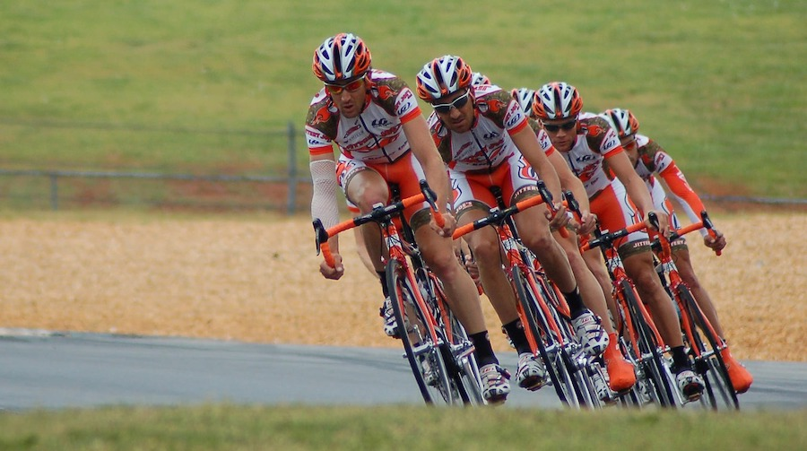 A team of race cyclists working together in perfect harmony