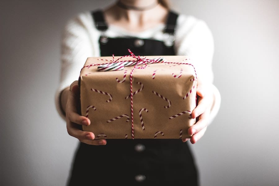 A person handing a present