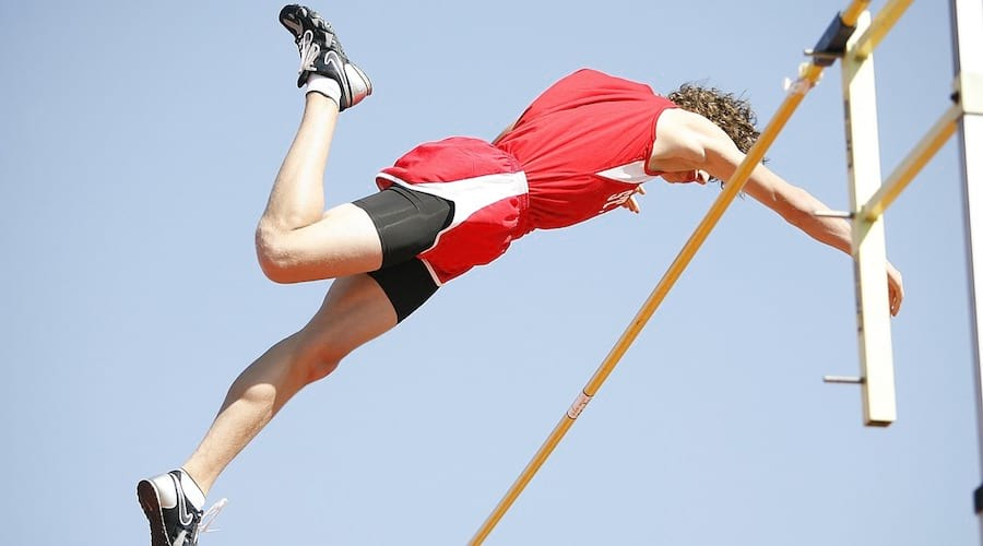 A pole vaulter crossing the bar